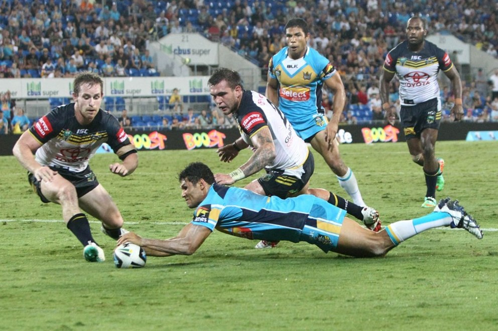 BRAD TIGHE SCORES THE WINNING TRY - NRL ROUND 4 -  GOLD COAST TITANS V NTH QUEENSLAND COWBOYS AT CBUS SUPER STADIUM, 31sth MARCH 2014. This image is for Editorial Use Only. Any further use or individual sale of the image must be cleared by application to the Manager Sports Media Publishing (SMP Images). PHOTO : CHARLES KNIGHT - SMP IMAGES