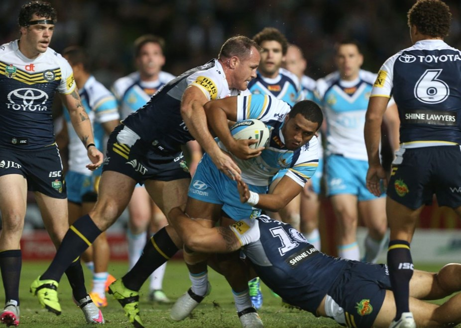 :		Digital image by Colin Whelan © copyright nrlphotos.com    Kalifa Faifailoa stopped by Matt Scott                  NRL  Rugby League, Round 26, North Queensland Cowboys v Gold Coast Titans at Townsville, Saturday September 5th 2015