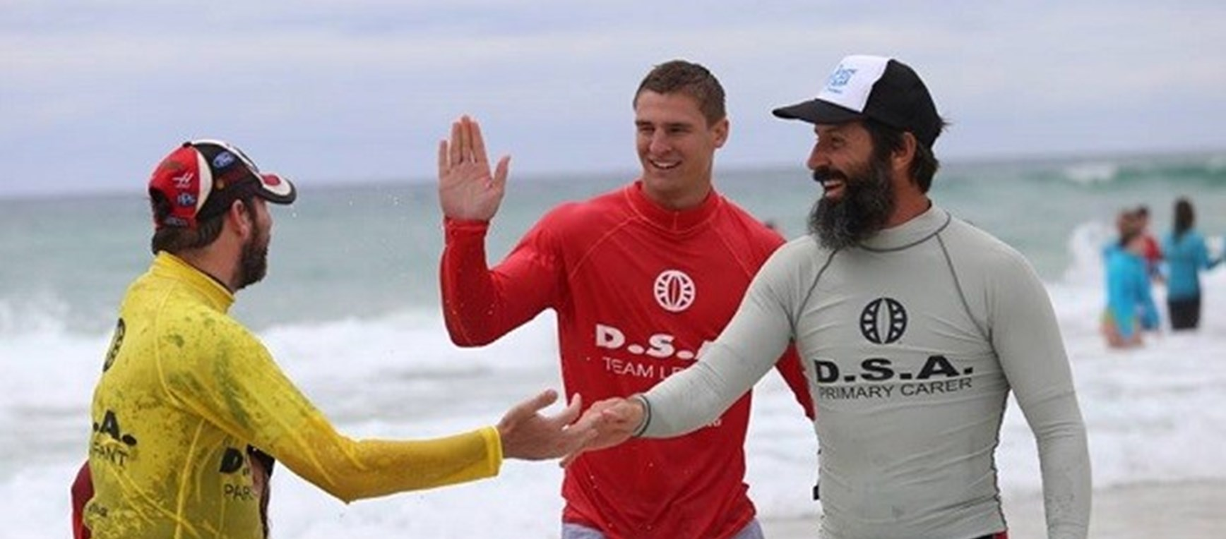 Titans players continue support for Disabled Surfers Association